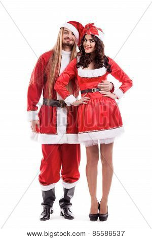 Attractive festive couple santa and girl isolated on white. Mr and Ms Santa