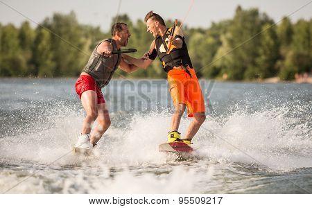 Two wake bord riders having fun