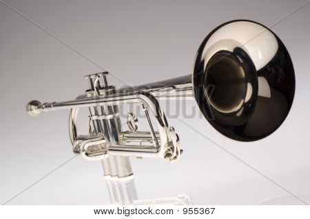 silver trumpet close up on gradient background poster