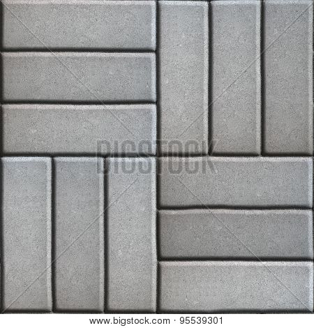 Gray Paving Slabs of Rectangles Laid Out on Three Pieces Perpendicular to Each Other.