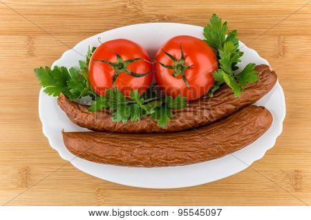 Sausage, Tomatoes And Parley In Dish On Bamboo Board
