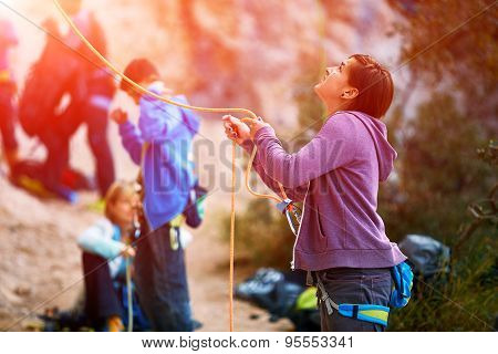 belayer with the rope and carabines