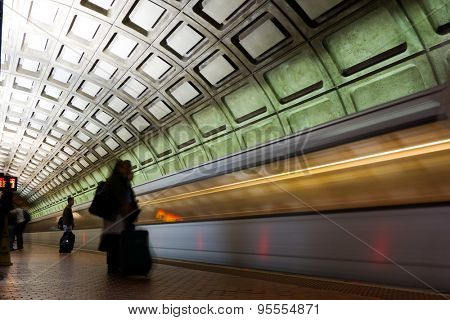 Subway station with passengers and train in motion blur - Washington DC, United States
