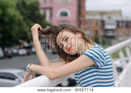Girl Listening To Music In The Background Of A Megacity