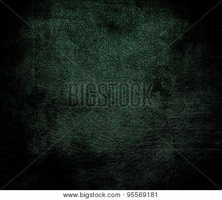 Grunge background of dark green leather texture