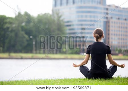 Young Office Woman Sitting In Yoga Pose