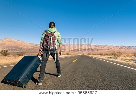 Man In The Desert With Luggage - Death Valley - California