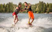 Two wake bord riders are having fun poster
