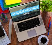 Affiliate Program Concept. Modern Laptop and Different Office Supply on Wooden Desktop background. poster