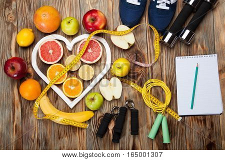 fitness background with lemon, dumbbells and centimeter healthy concept with lemon, dumbbells and centimeter