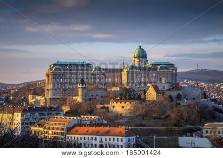 Budapest Hungary - The famous Buda Castle (Royal Palace) St. Matthias Church and Fishermen's Bastion at sunset on a nice winter afternoon taken from Gellert Hill