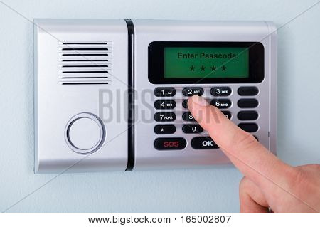Close-up Of Person's Finger Entering Code In Security System