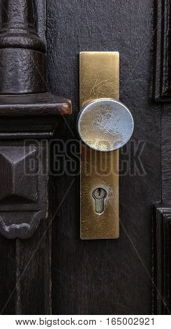 Golden scratched and heavy used doorknob details