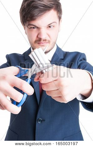 Selective Focus Of Mad Man Cutting Cigarettes