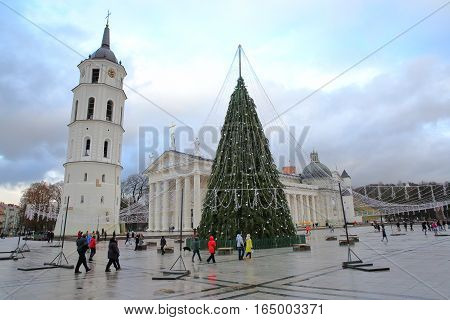 VILNIUS, LITHUANIA - JANUARY 2, 2017: The Belfry (Cathedral Clock Tower) and a Christmas tree on Cathedral Square with the cathedral in the background
