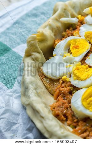 Super Spanish pies or empanadas stuffed with tuna vegetables and eggs.