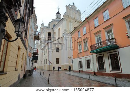 VILNIUS, LITHUANIA - JANUARY 2, 2017: Dominikonu Street with colorful facades and the Dominican Church of the Holy Spirit in the background