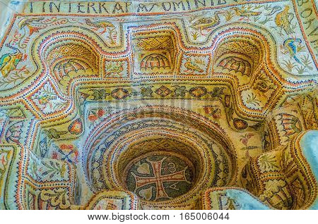 SOUSSE TUNISIA - SEPTEMBER 1 2015: The ancient baptistery covered with mosaics with floral and animalistic patterns and with big cross in the middle on September 1 in Sousse.