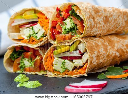 Healthy vegan salad tortilla wraps with tofu and vegetables. Love for a healthy raw food concept.