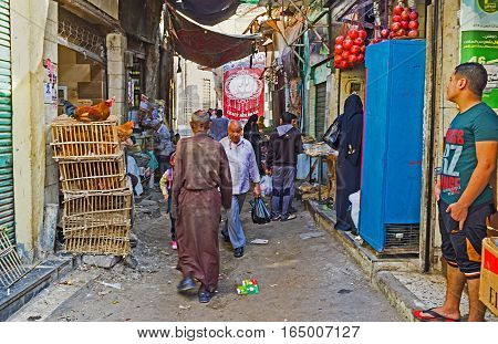CAIRO EGYPT - OCTOBER 12 2014: The old food market with different agricultural products located next to Al-Azhar Mosque on October 12 in Cairo.