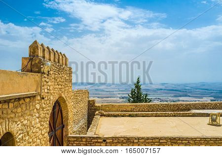 The high ramparts of Kasbah with the scenic hilly landscape on the background El Kef Tunisia.