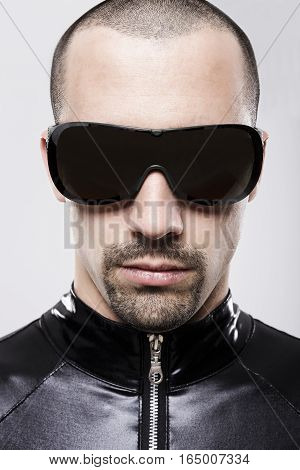 Portrait of futuristic man with sunglasses over white background