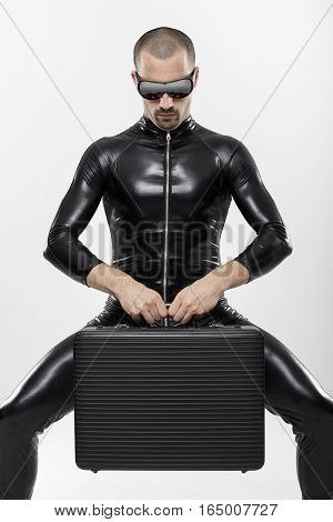 Futuristic businessman with briefcase over white background