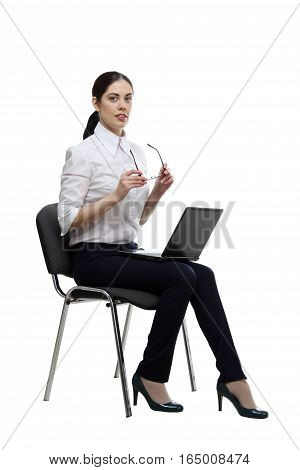 Beautiful business woman with laptop on white.