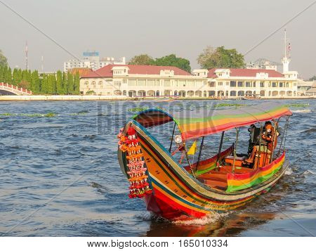 BANGKOK, THAILAND - JANUARY 16, 2014: Chao Phraya River and Thai traditional boat. Bangkok, Thailand