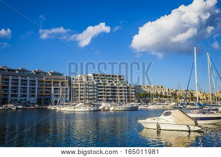 Msida Malta - Jacht marina at Msida with blue sky and clouds on a beautiful summer day