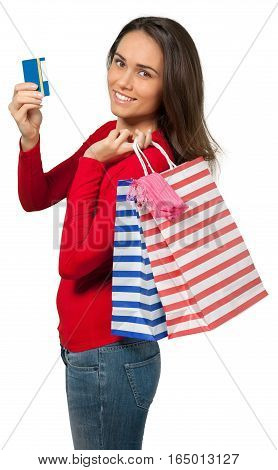 Young woman holding shopping bags and a credit card