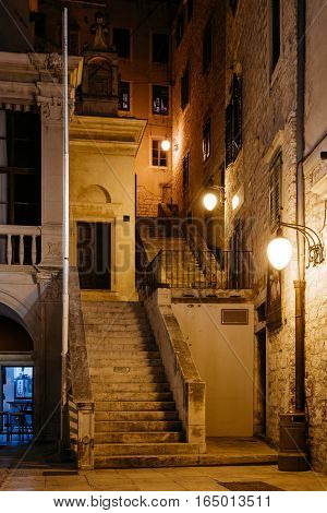 empty night street with stairs in the historic center of Sibenik, Croatia.