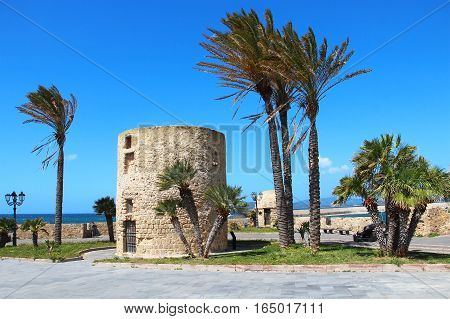 Fortification tower and walls in Alghero old town, Sardinia, Italy