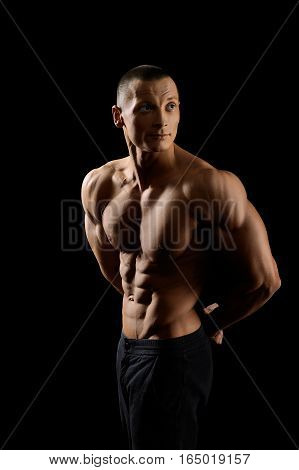 Committed to sports. Handsome young fitness man with ripped strong and toned body looking away thoughtfully
