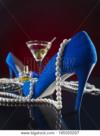 Blue Velvet Shoes With Jewelry And A Martini Glass