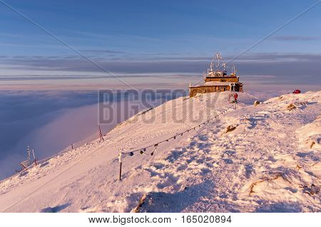 The summit of Kasprowy Wierch during sunset and inversion. Tatry. Poland