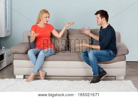 Sad Stressed Couple On Couch Quarreling About Infidelity With Each Other At Home