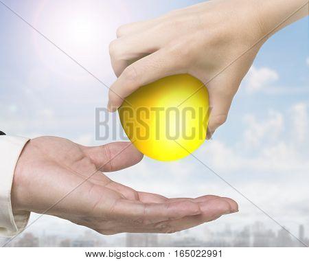 Hand Giving One Golden Egg