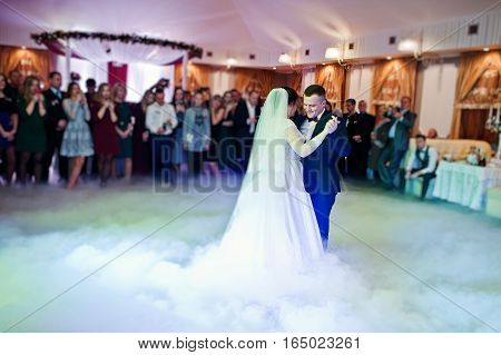 First Wedding Dance Of Newlyweds On Heavy Smoke.