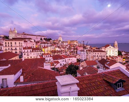 Cityscape of Lisbon Portugal seen from Portas do Sol at sunset.