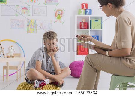 Child Having Conversation With Psychotherapist