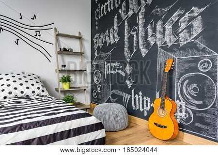 Unisex Teenager Interior With Guitar