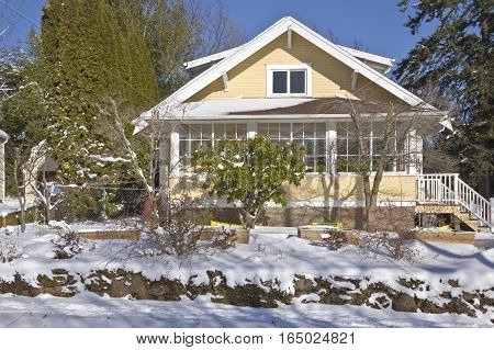 Family home and snow covered ground Gresahm Oregon.