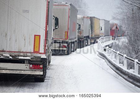 Traffic Jam Of Trucks In Snowstorm
