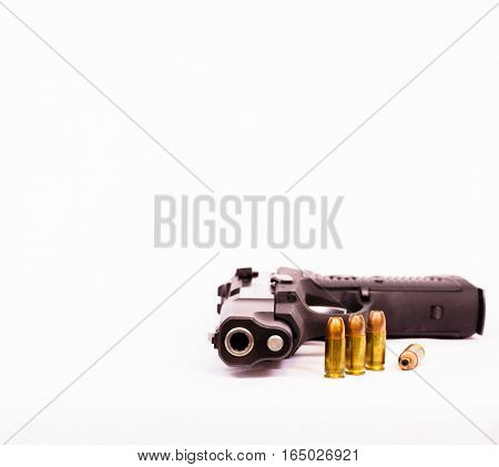 Vertical image of a 9mm pistol and ammunition with a white background.