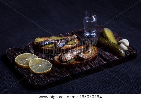 Still life with sprats, vodka and pickles