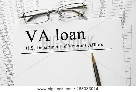 Paper with VA loan on a table