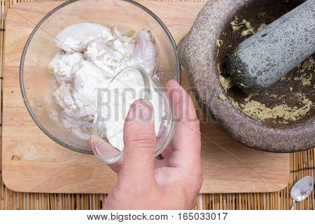 Chef putting flour to chicken wings for cooking / cooking fried chicken wings concept