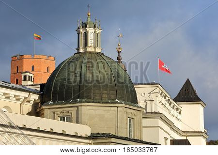 VILNIUS, LITHUANIA: The top of the Palace of the Grand Dukes of Lithuania with the castle on Gediminas Hill in the background