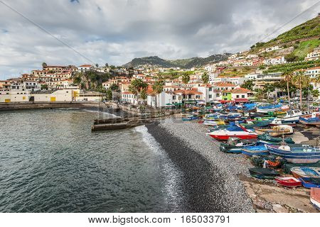 Camara de Lobos Madeira Portugal - December 10 2016: Camara de Lobos near Funchal Madeira Island in cloudy weather. In this fishing village Winston Churchill spent much time for paining.